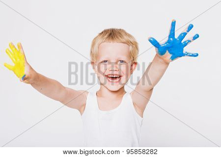 Boy with hands painted in colorful paints ready to make hand prints. School. Preschool. Education