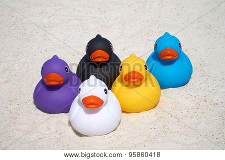 Five Rubber Ducks On The Beach