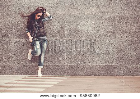 girl is walking in the downtown