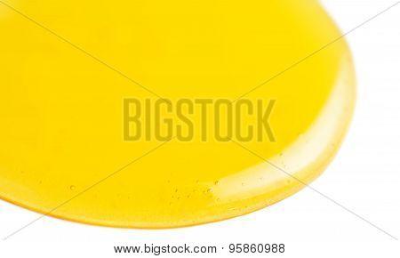Honey Drips. Yellow Honey Flowing Liquid Drop Isolated On White Background Macro.