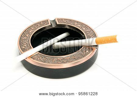 Two Cigarettes In Ashtray On White
