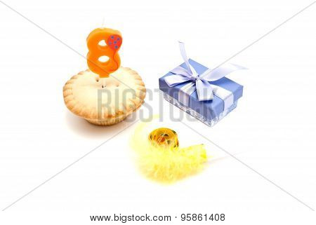 Cupcake With Eight Years Birthday Candle, Gift And Whistle On White