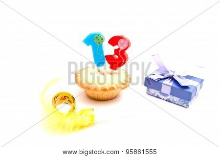 Cupcake With Thirteen Years Birthday Candle, Gift And Whistle