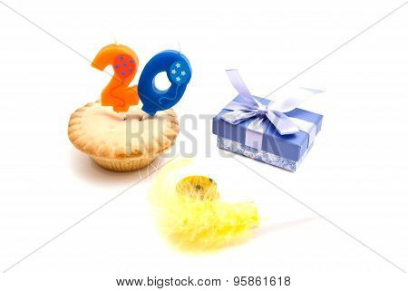 Cupcake With Twenty Years Birthday Candle, Whistle And Gift