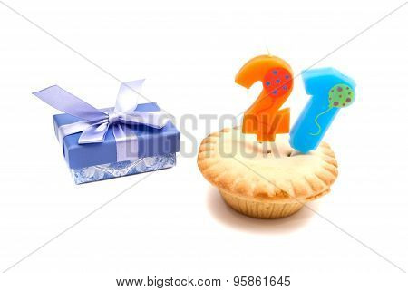 Cupcake With Twenty One Years Birthday Candle And Gift On White