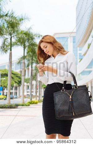 Woman messaging on phone