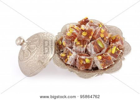 Turkish Delights With Pistachio Nut In A Metal Sugar Bowl Isolated On White Background