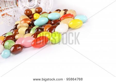 Candy Beans With Glass Jar On White Background With Copyspace