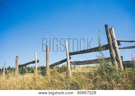 Old wooden fence and blue sky, country living