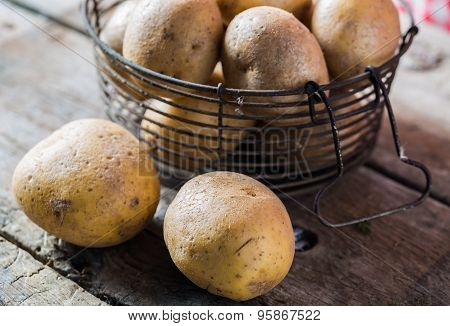 Fresh Young Potatoes In A Basket