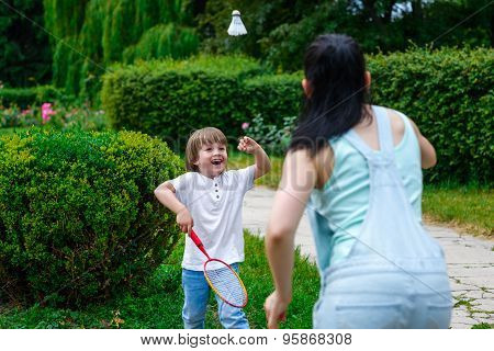 Mother and son playing badminton in the park