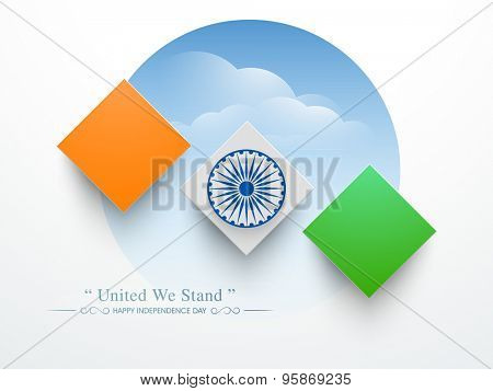Glossy tricolor squares with Ashoka Wheel on shiny cloudy background for Indian Independence Day celebration.