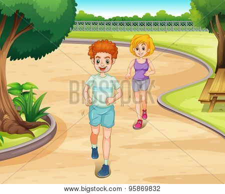Couple jogging in a park with greenery environment