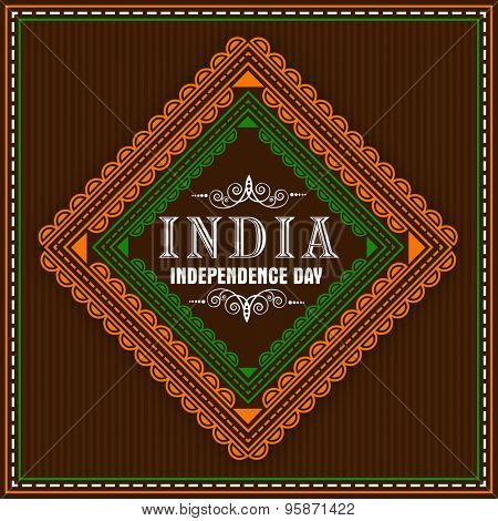 Greeting card decorated with floral pattern in national tricolor on brown background for Indian Independence Day celebration.