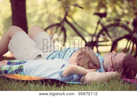 Young Father With Little Sun At Summer Park