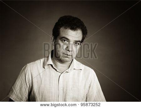 Black and white studio portrait of a mature man