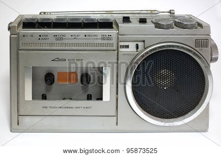 Retro blaster cassette tape recorder isolated on white background