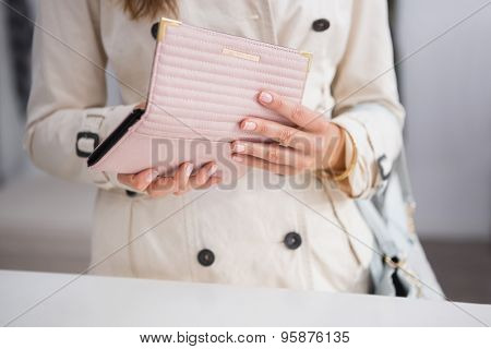 Woman opening her wallet at a boutique