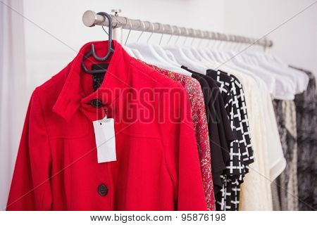 Hanging red coat at a boutique