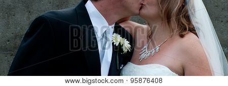 Wedding couple sharing an intimate kiss