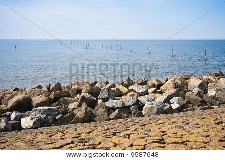 Breakwater Of Rocks At Dutch Coast