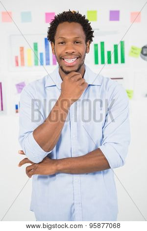 A smiling young business man looking at the camera