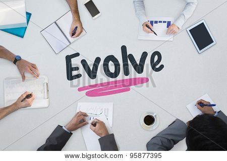 The word evolve against business meeting