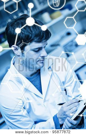 Science graphic against concentrated scientist writing on a clipboard