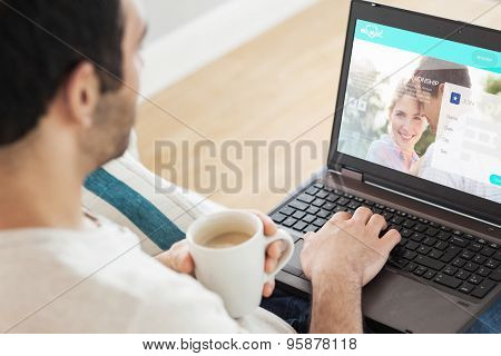 Man using laptop against dating website