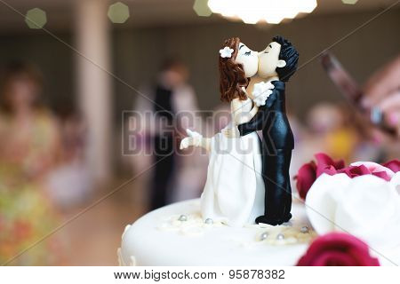 Beautiful chocolate figurines on top of wedding cake