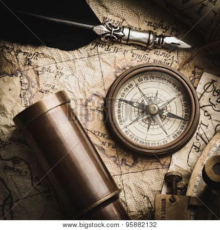 vintage still life with compass,sextant spyglass and old map