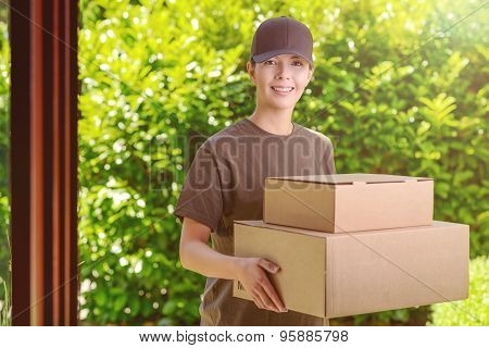 Attractive Delivery Woman With Two Cardboard Boxes