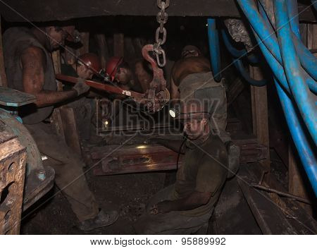 Donetsk, Ukraine - August 16, 2013: Miners Mounted Equipment In Close Underground Slaughter. Mine Is