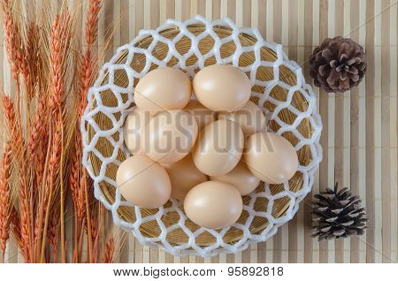 Easter Egg In A Basket With Cone And Barley.