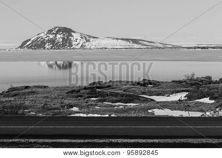 Black and white of snowy mountain and lake