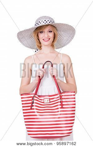 Pretty girl in elegant hat holding red white stripped bag. Smiling fashion woman. Isolated