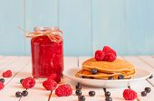 picture of mason  - Stack of wheat golden pancakes or pancake cake with freshly picked blueberry on a dessert plate - JPG