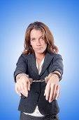 picture of handcuff  - Female businesswoman with handcuffs against gradient  - JPG