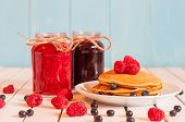 pic of mason  - Stack of wheat golden pancakes or pancake cake with freshly picked raspberries on a dessert plate - JPG