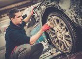 foto of alloys  - Man worker washing car - JPG
