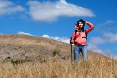 Tourist Woman In Mountains poster