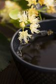 image of teapot  - teapot and cup with linden tea and flowers - JPG