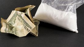 picture of methadone  - Single large bag of the cocaine drug and crumpled American dollars - JPG