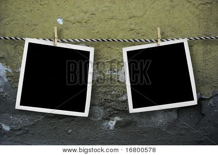 Two pictures on a rope.