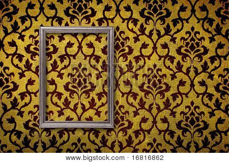 Silver frame on a vintage yellow wall background