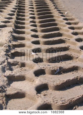 Imprint Of Tiretracks In The Sand