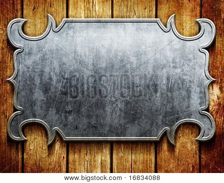 Vintage metal signboard on old wooden planks