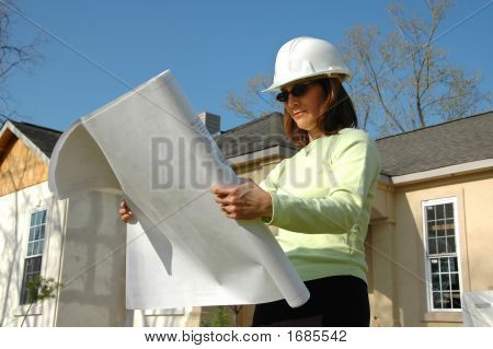 Architect With Blueprints And Hard Hat