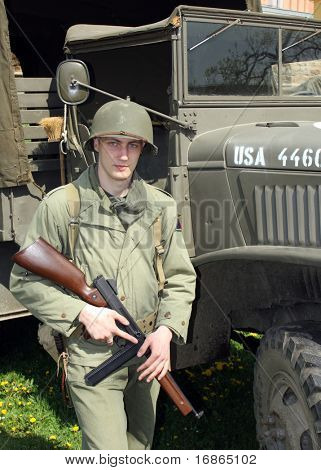 American soldier before military truck in Pilsen City Czech Republic Europe - Anniversary ends second world wars