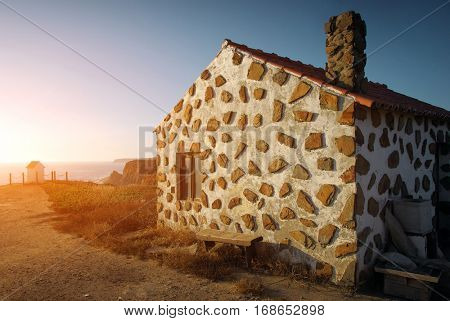 House on the cliff of the Atlantic Ocean coast in the Alentejo region of Portugal